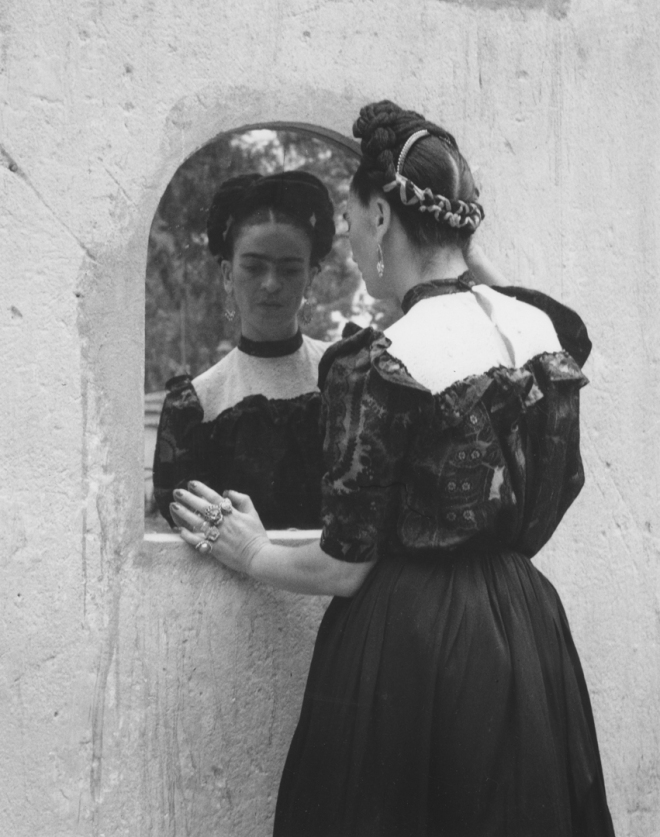 1944, Frida Looking Into Mirror. by Lola Alvarez Bravo